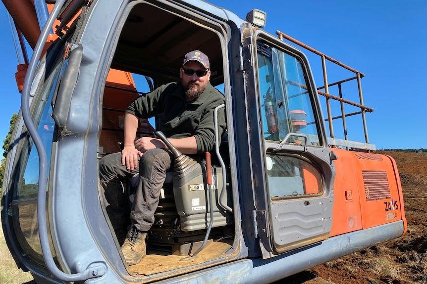 Oldina farmer Nick Newman sits in the excavator he has used to convert a plantation back to farmland.