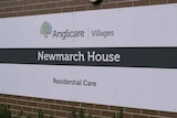 a sign reading anglicare villages newmarch house residential care