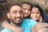 Virendrasinha Bhosale is embraced by his son and wife in this selfie taken after he returned home.
