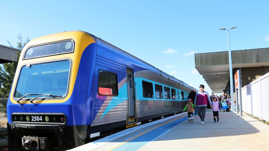Passengers prepare to board a train at Canberra station in Kingston.