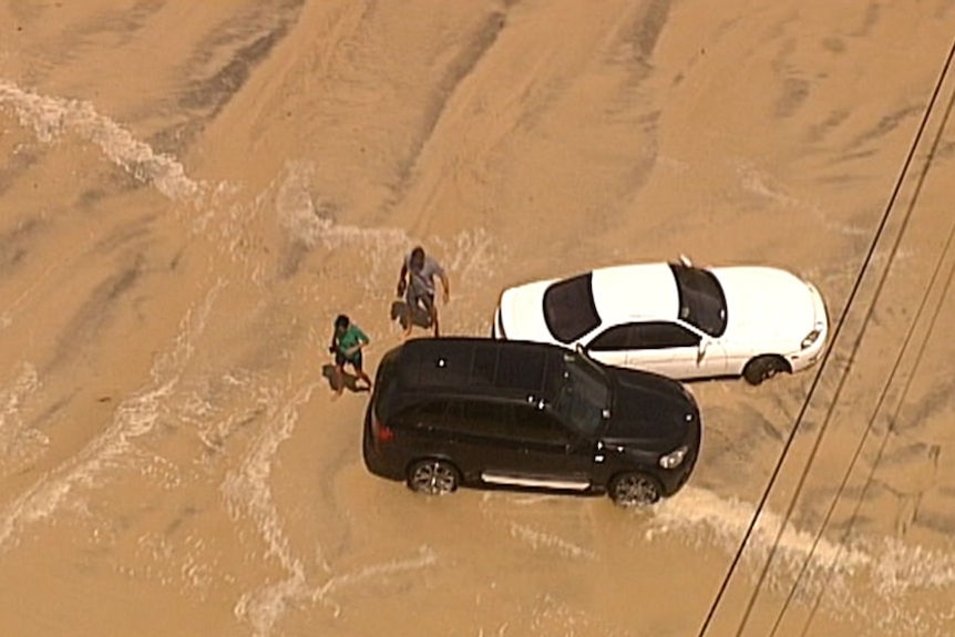 Waterlogged cars and eroded beaches on the Gold Coast