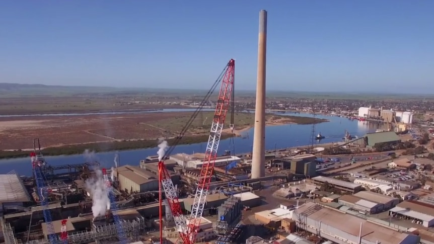 Port Pirie smelter viewed from air with a river in the background.