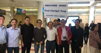 Chongyi Feng returns to Australia after being detained in China.