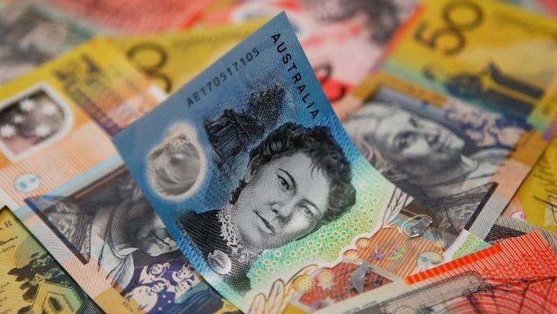 Various denominations of notes of Australian money.