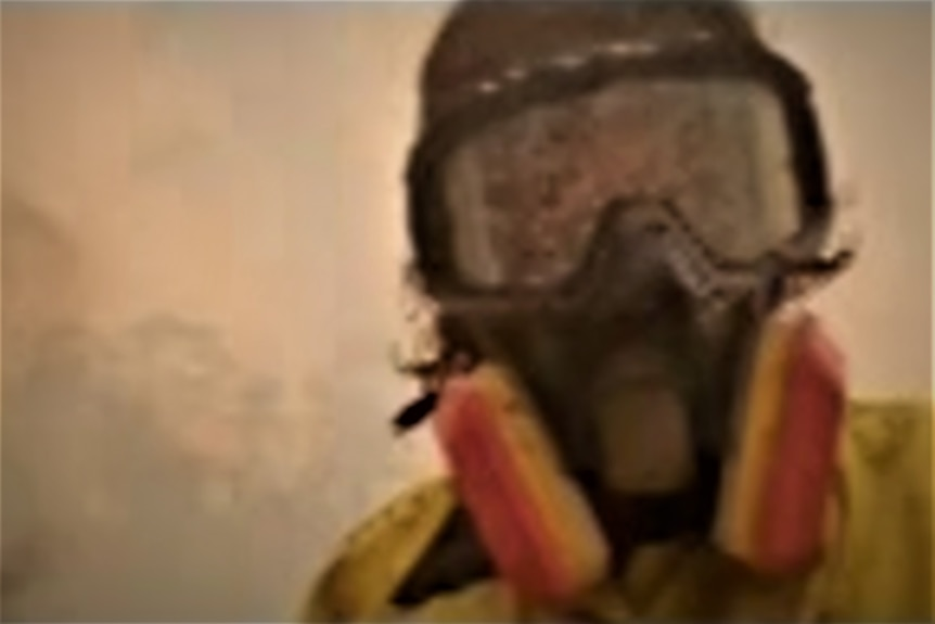 Selfie of in goggles and face mask surrounded by bushfire smoke