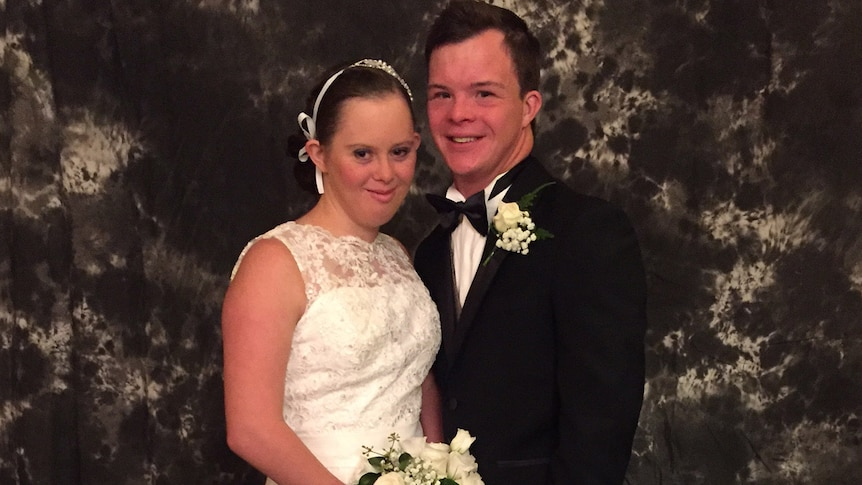 Queensland couple Taylor Anderton and Michael Cox pose for a photo at the Debutante Ball for young women with disabilities
