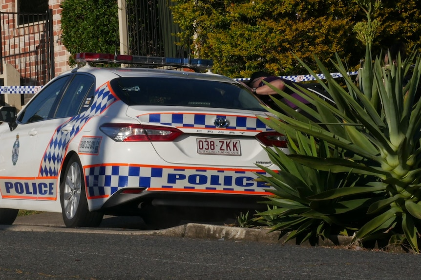 Police car and tape at the scene of an alleged murder in Newmarket