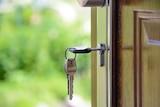 Keys rang from lock, in a front door.