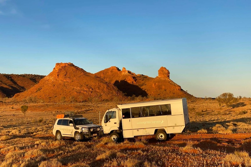 A photo of the Sandrifter Safaris fleet in a scenic location in the desert.
