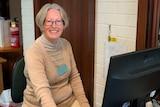 Bunbury Seniors Computer Club secretary Maureen Davies sitting at a computer at the club.