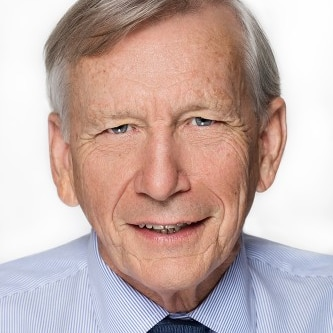 Man wearing a tie and smiling.