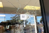 Business window with a bullet hole