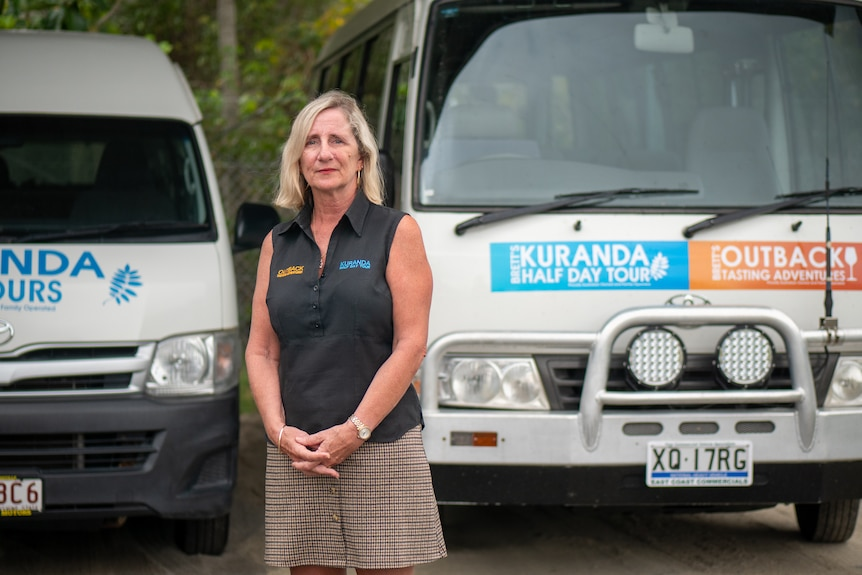 Tour operator Andrea Cameron stands in front of her buses, Port Douglas.