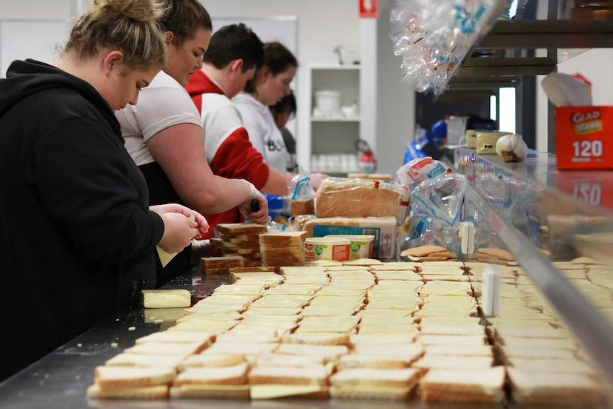 Vegemite and cheese sandwich-making production line