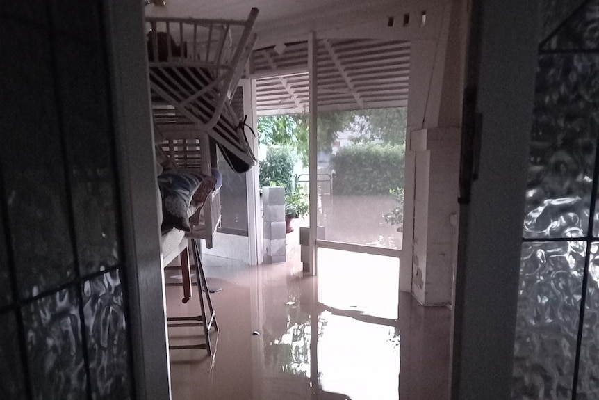 Floodwaters inside a home, coming up 15 centimetres above the floorboards