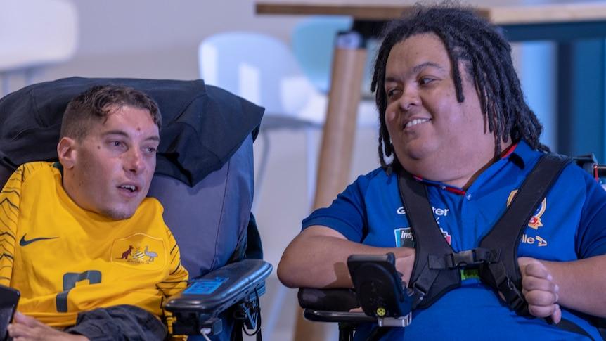 Poweroos teammates Abdullah Karim (left) and Dimitri Liolio-Davis at the Powerchair FootballWorld Cup launch in Sydney on Thursday.