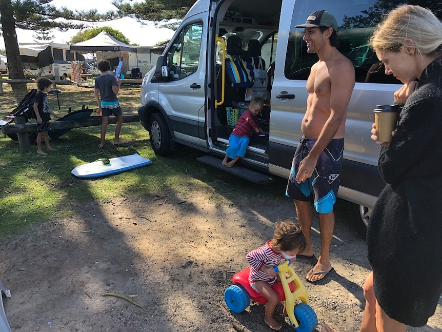 Travellers Peter and Hayley McGregor with their four boys at their van at a Crescent Head, NSW.