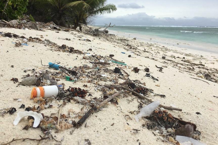 Close up of plastic debris and rubbish on a Cocos Island beach
