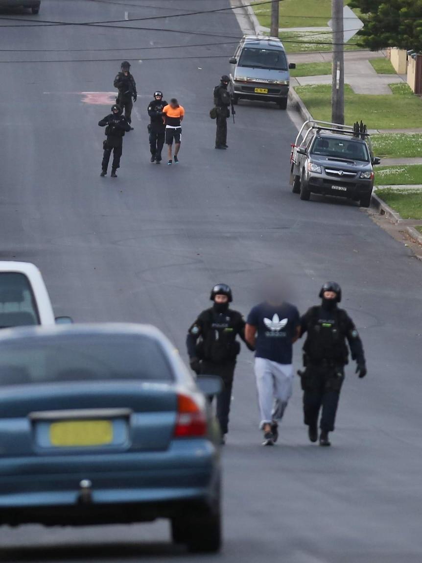 People led away after terror raids