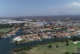 Aerial view of houses built around canals
