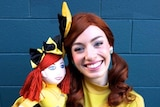 Yellow Wiggle Emma with an Emma doll