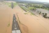 Rockhampton Airport runway partly underwater