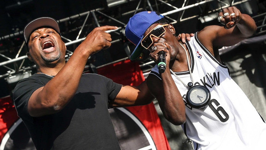 Public Enemy rappers Chuck D and Flavor Flav perform on stage.