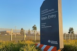 A sign outside the Post Entry Quarantine Facility in Mickleham on a golden sunny morning.