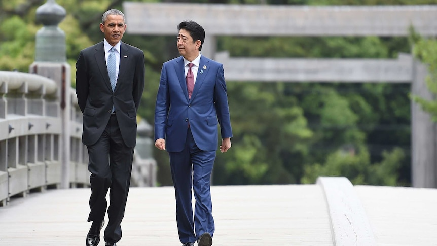 Barack Obama walking with Japanese Prime Minister Shinzo Abe.