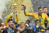 France celebrates with World Cup trophy