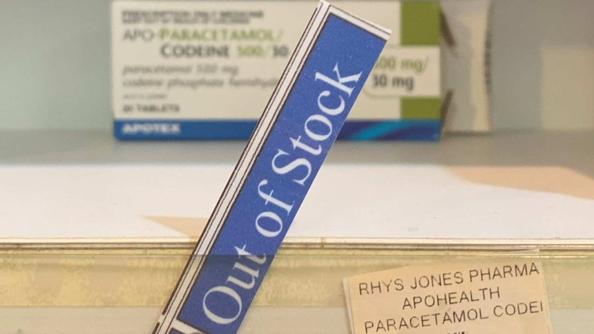 Out of stock sign on medicine shelf.