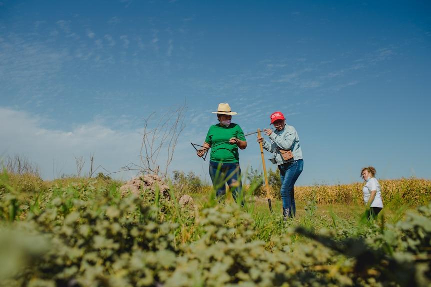 Two women in a field.