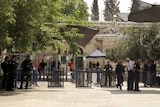 Israeli border police officers stand near newly installed cameras at the entrance to the Al Aqsa Mosque.