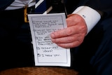 A hand holds a piece of paper with five bullet points on how to speak to students affected by the Florida shootings.