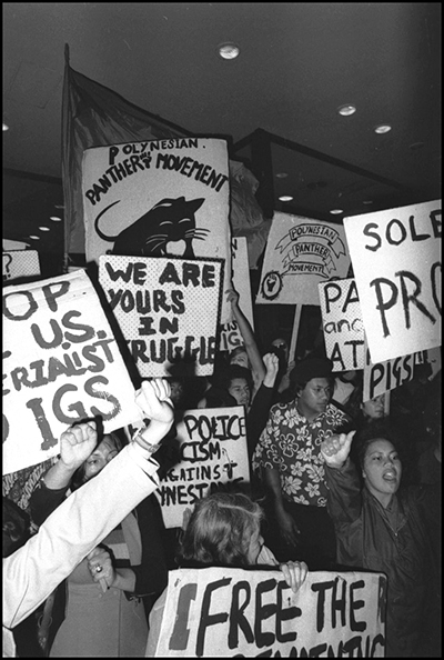 A shot of a group of protest signs and young people.