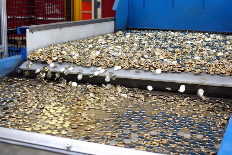 Two dollar coins on the way to be stamped at the Royal Australian Mint.