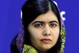 Malala Yousafzai listens during the World Economic Forum.