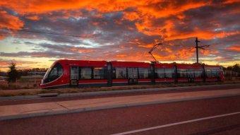 Light rail against the sunset.
