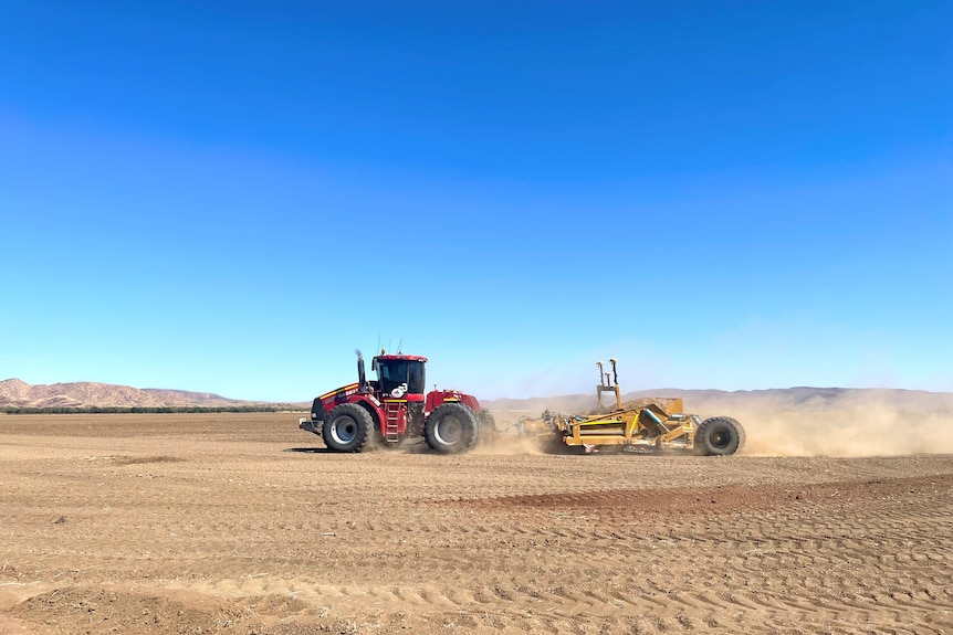 A tractor leveling farmland in the Ord