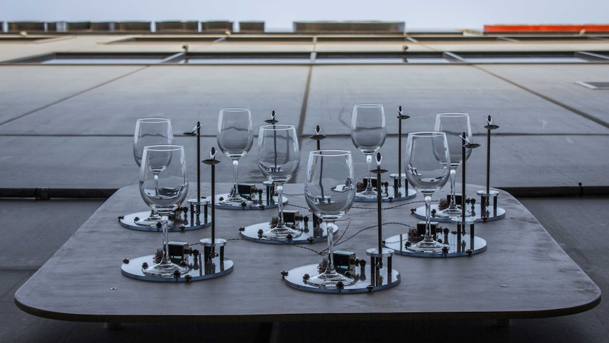 One of five panels of wine glasses and spoons in the Toast art installation.