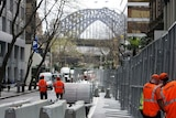 Security crackdown: Construction workers erect a fence around parts of the Sydney CBD
