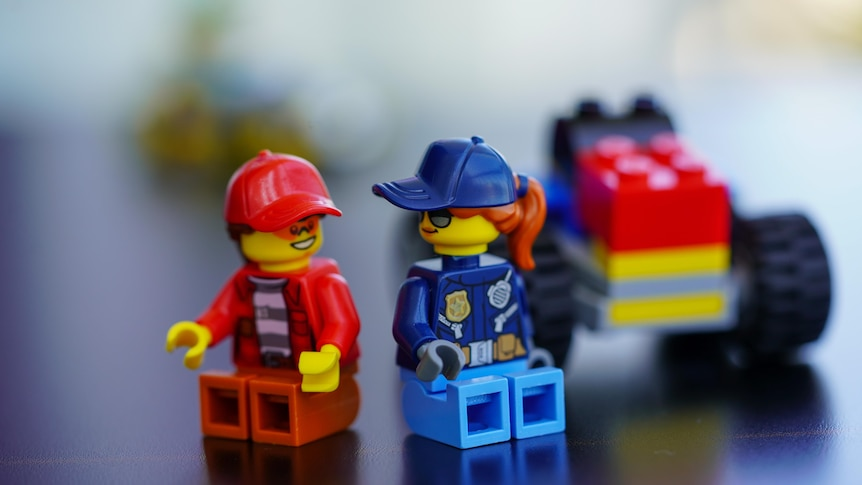 Two pieces of LEGO people talking to each other.