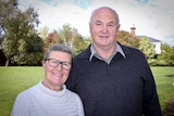 John and Willemina Watts standing in a park.