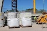 a construction site and crane and workers