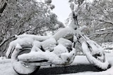 Motorbike covered in snow