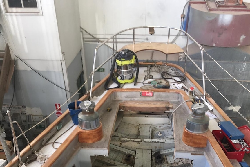 Exposed timber below the aft seats.