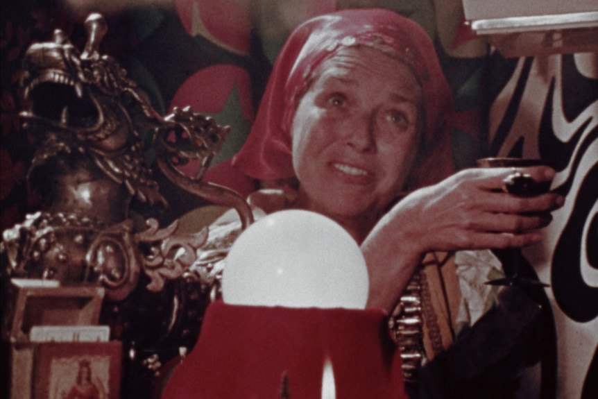 Film still of a fortune teller with a crystal ball in The Amusement Park