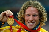 Steve Hooker shows off his gold medal at the 2008 Beijing Olympics.