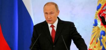 Vladimir Putin giving a speech.