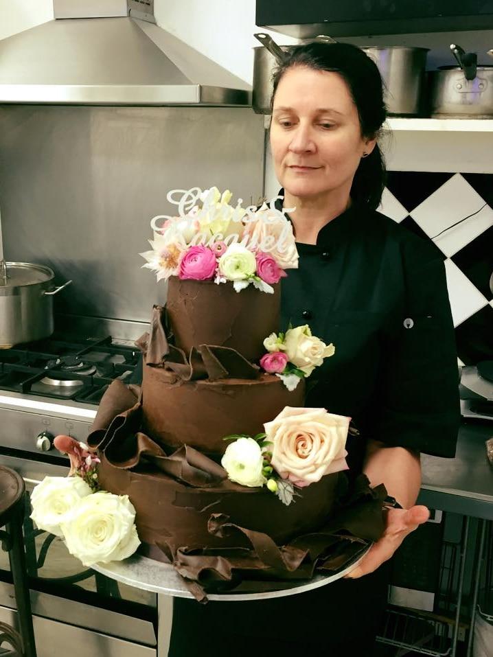 Jodie Van Der Velden with giant chocolate cake